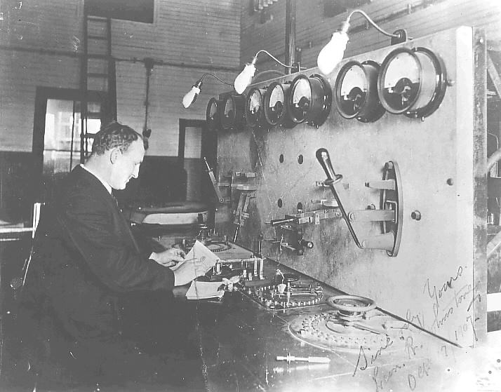 Marconi in front of some huge device